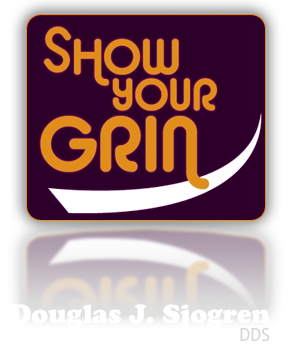 A clickable image of Show Your Grin Dental logo, orange letters on a purple background, to return to home page.