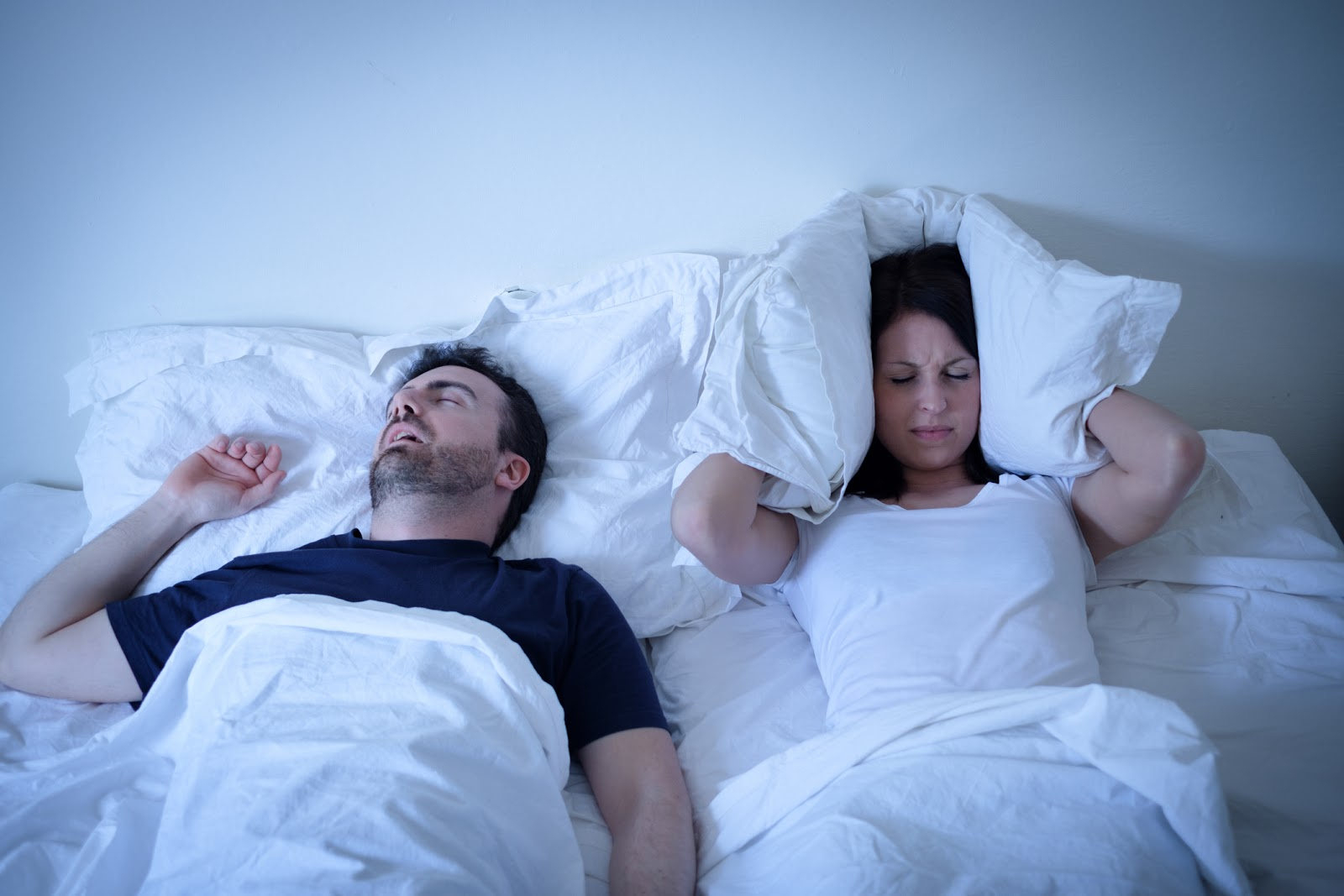 Woman unhappy as man snores in his sleep