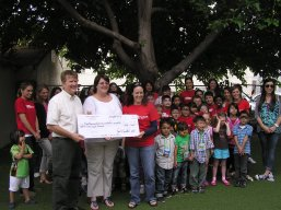 Dr. Sudick joined students and teachers at Oralingua School for hearing impaired children in Uptown Whittier to present a check for $1,200.00 for computers to teacher Krista Santanna (right) , and development coordinator Tracie Cargill (middle) at their annual carnival on Friday June 17th.