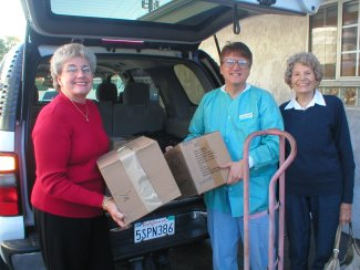Dr Sudick donating toothbrushes to Assistance League